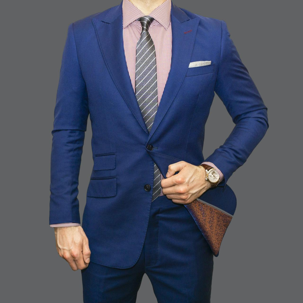 man in blue suit jacket and black pants